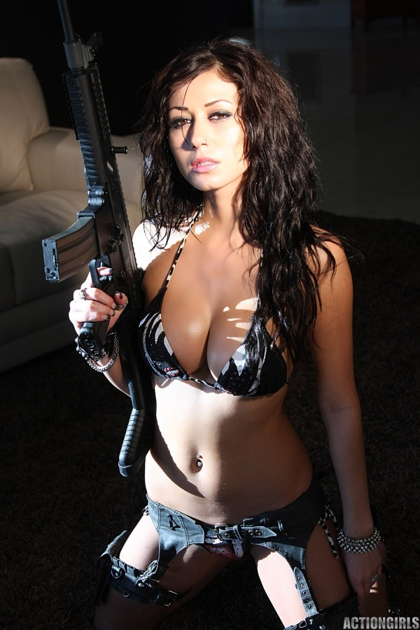 Nude women with machine guns