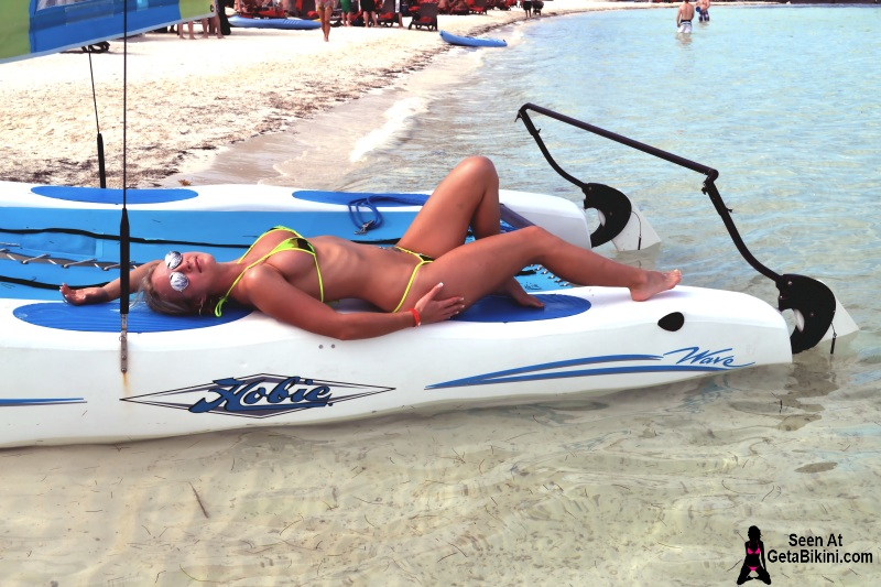 girl in bikini laying on katamarn jet ski