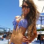 celebrity wanabee girl in bikini under umbrella