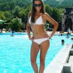 sweet stuff bikini girl posing by pool